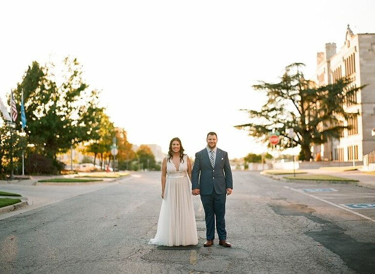 bride and groom holding hands on street Oklahoma City