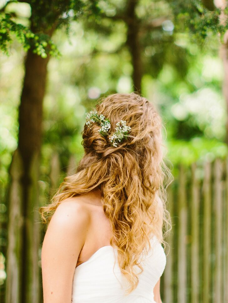 Marisa wore her hair in a loose, natural half-updo and accented it with baby's breath.