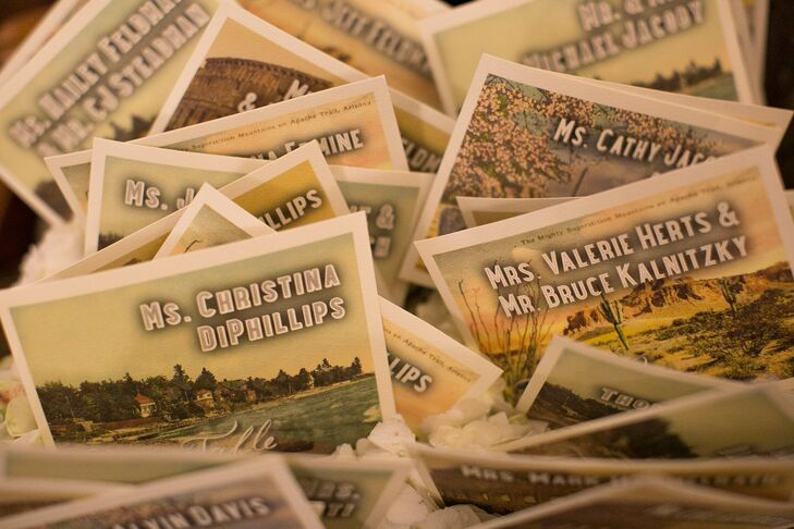 Custom postcards from places Tara and Adam had visited together served as escort cards.