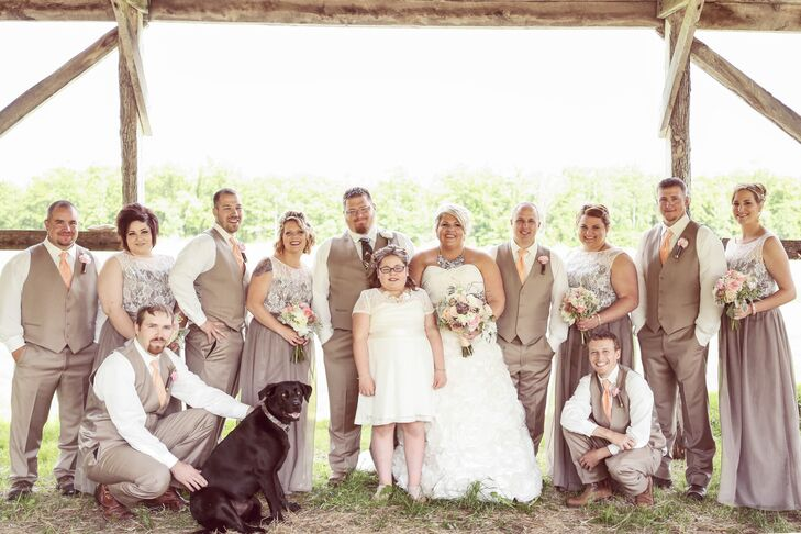 Jon and the groomsmen wore taupe suits for the casual country wedding. Katie and Jon wanted something a little different and less stuffy, and brown fit their look. Although the groomsmen wore peach ties, Jon stood out with a camouflage tie. The bridesmaids added a little vintage flair to the look with lace overlay on the bodice of their mocha dresses. It all worked together!