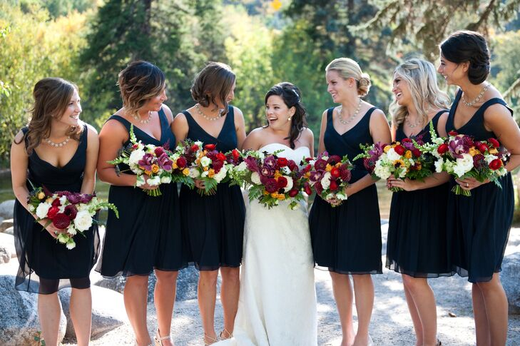 The bridesmaids wore navy J. Crew cocktail dresses with nude shoes. rn