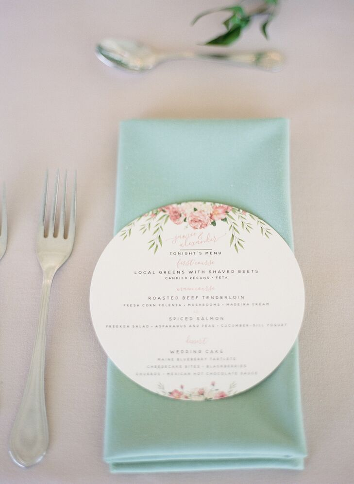 Each place setting included soft green napkins and round menus with the same design from the couple's wedding invitations.