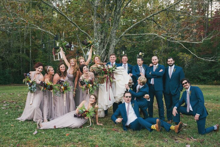 Fall was the main theme of the wedding, incorporating plenty of herbs, plants and natural greenery. The groomsmen wore shades of blue, camel and cranberry, while bridesmaids wore neutral tones, also with cranberry.