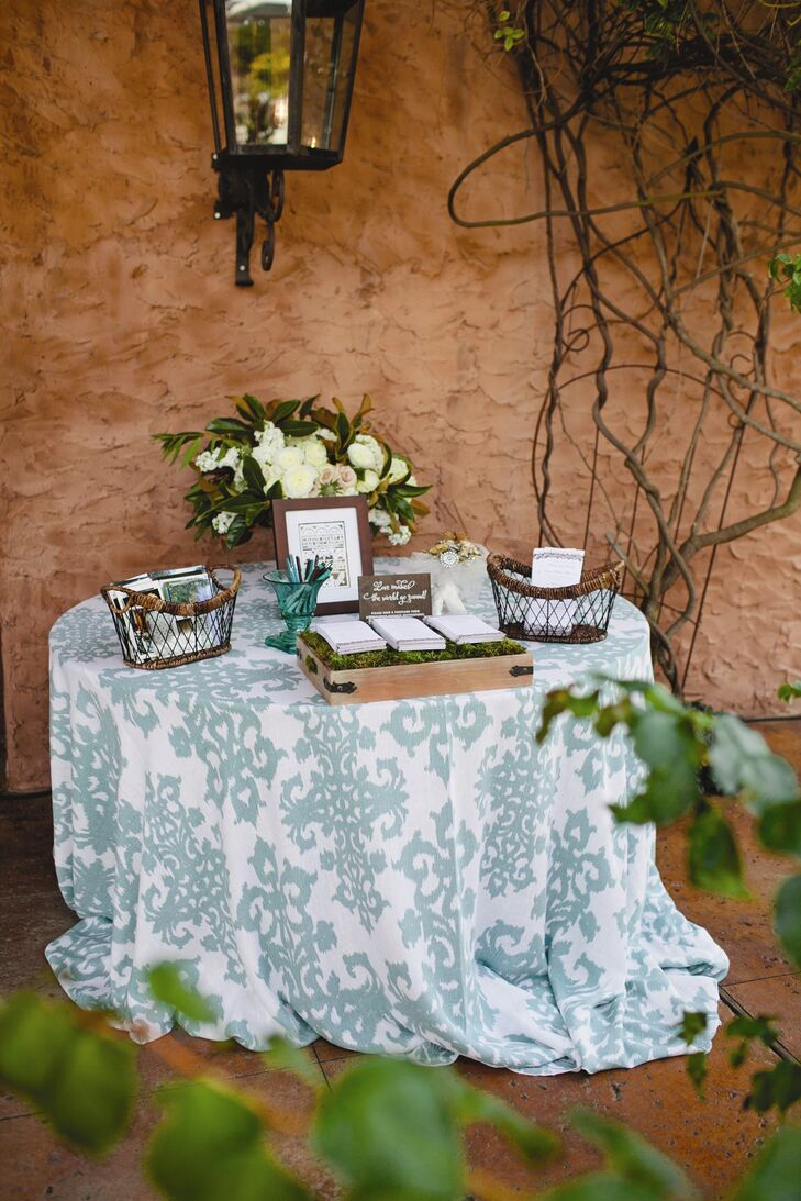 The thoughtfully designed programs sat on a table topped with green and white tablecloth at the entrance to the ceremony area.