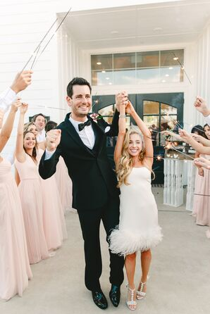 Formal Groom and Bride in Short, Feathered Dress Making Sparkler Exit