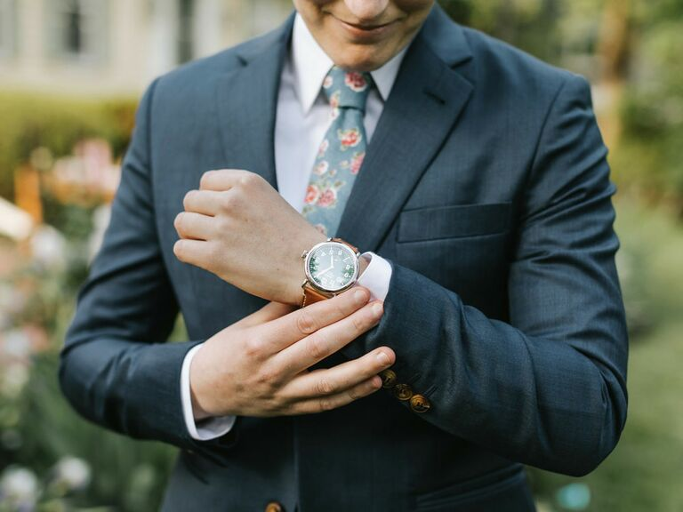To-be-wed wearing floral tie and navy suit jacket for summer wedding