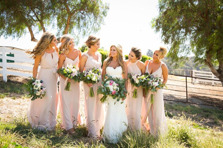 Lindsey's closest friends wore different styles of long Joanna August dresses in blush tones. They accessorized with neutral wedges and the gold earrings and bracelet that Lindsey had given them as gifts.