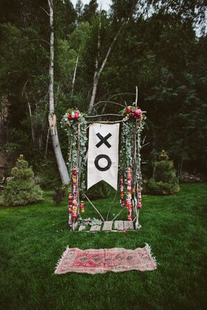 Boho Hanging Floral and Banner Wedding Arch