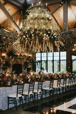 Modern Rustic Reception with String Lights and Hanging Flower Installation