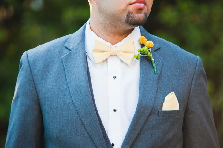 While the groomsmen wore gray suits with notched lapels, they made sure to add a hint of color. Each sported a yellow bow tie, matching pocket square and a bright, bold boutonniere from Jonathan's Flowers. The arrangements had yellow craspedia and green hypericum berries for a natural touch.