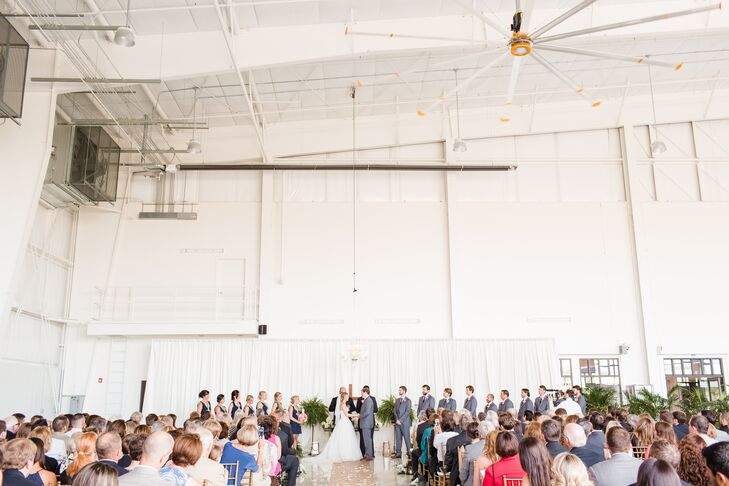 "The ceremony took place Zaxby's Hangar in Winder, Georgia, where Kelsey and Andrew said ""I do"" under a crystal chandelier in front of a mahogany table altar draped in flowers and candles. They participated in the sand-unity tradition and combined sand from the beaches each used to visit."