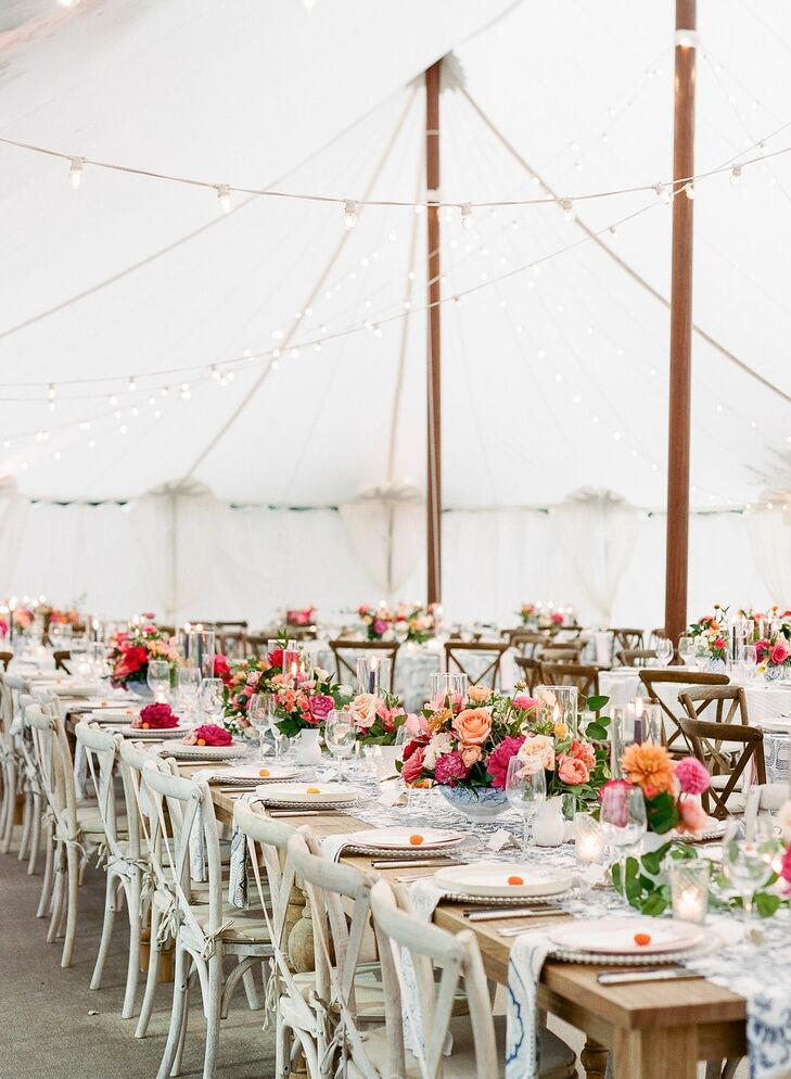 Romantic Tented Reception with Farm Tables and Flower Centerpieces