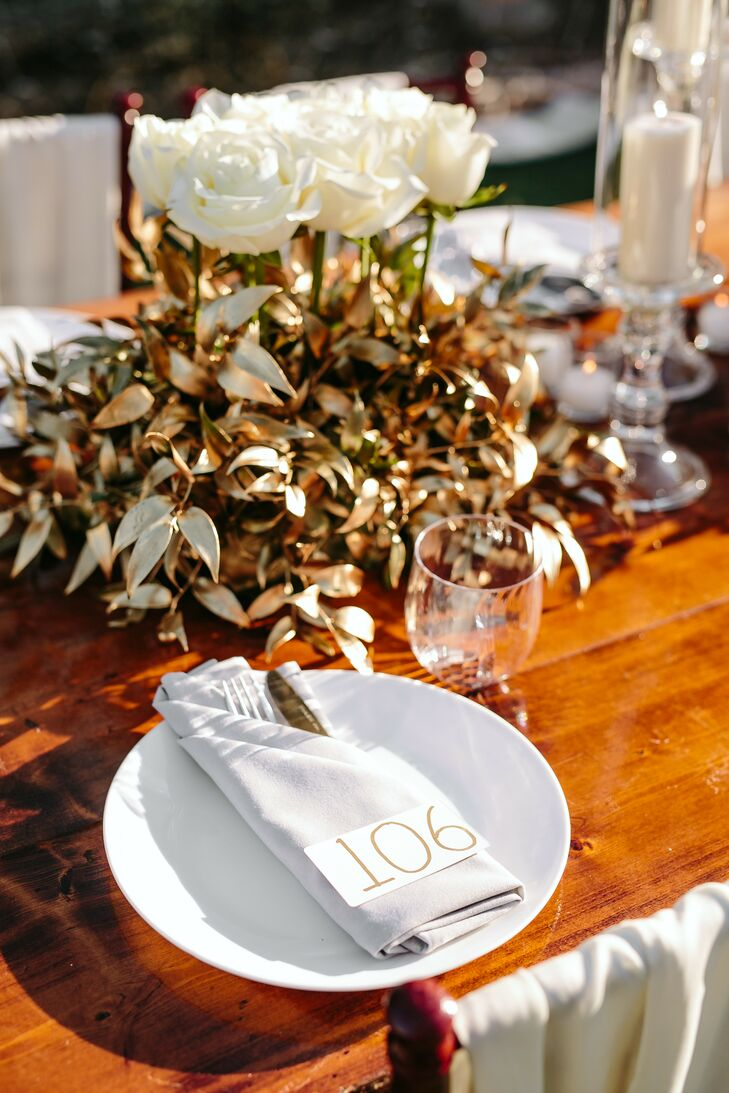 Gold Centerpieces and White Place Settings