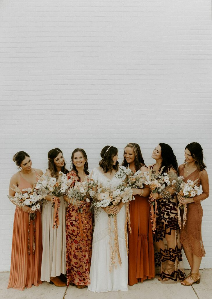 Bohemian Bridesmaids Wearing Mismatched Orange Dresses