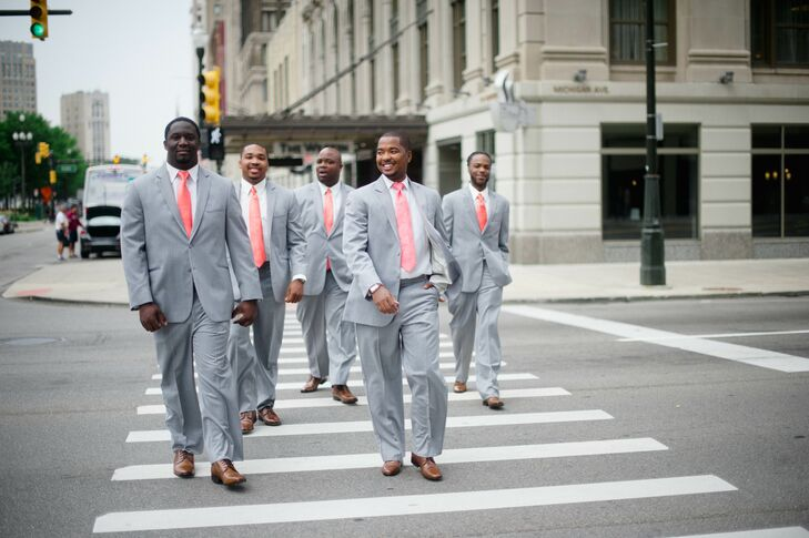 Jeremy and his groomsmen wore these matching heather gray suits, brown dress shoes and bright coral ties that matched the bridesmaid dresses. Wanting to stand out a bit, Jeremy paired his look with a paisley tie.