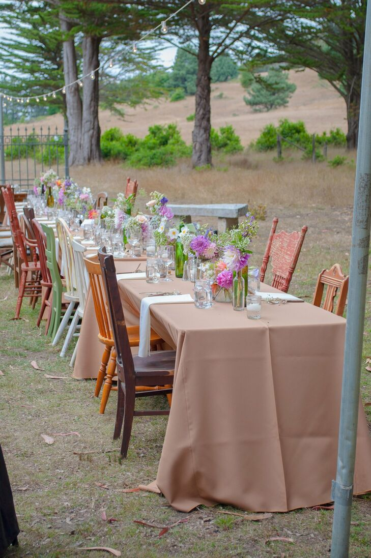 Mismatched vintage chairs added a charming touch to the table decor.