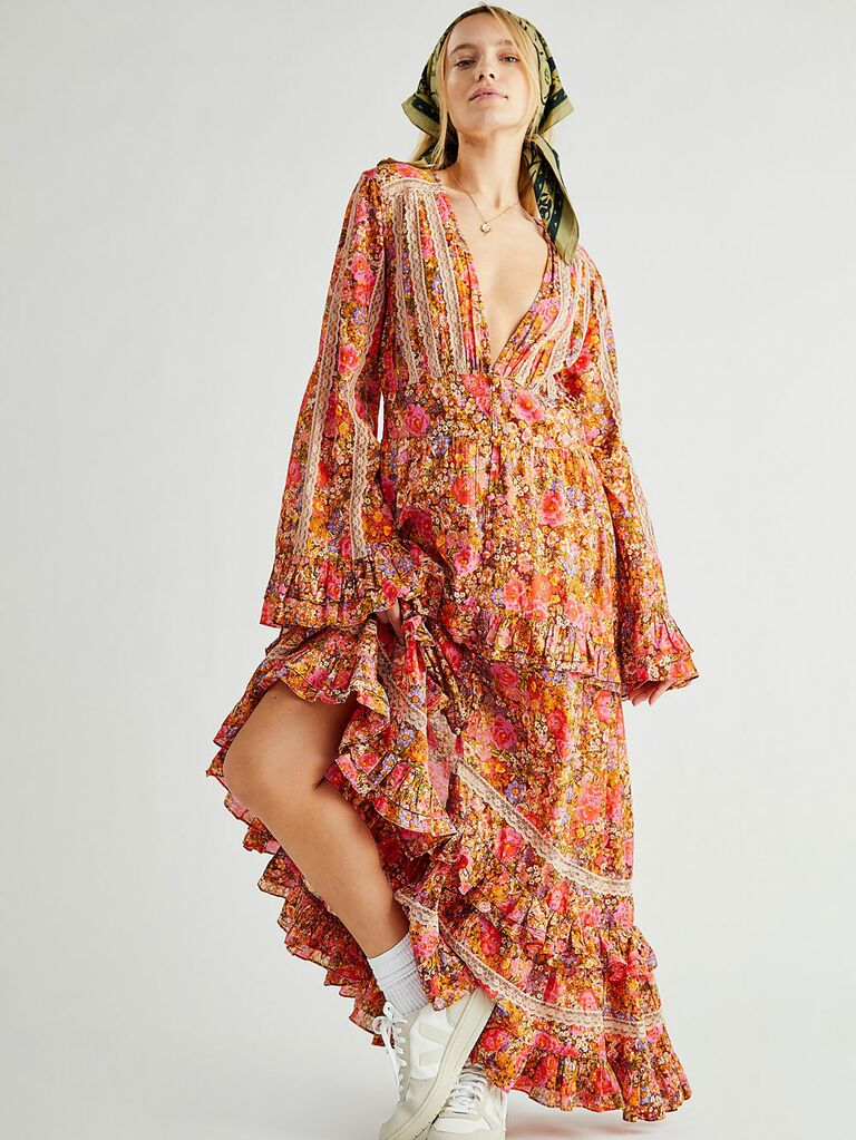Vibrant pink and yellow floral cottagecore dress with full skirt and long bell sleeves
