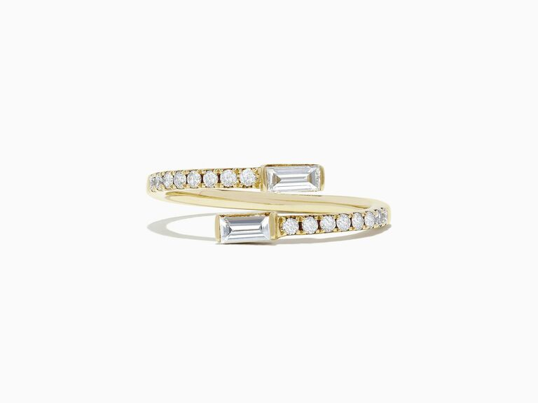 small diamond baguette two stone ring in yellow gold