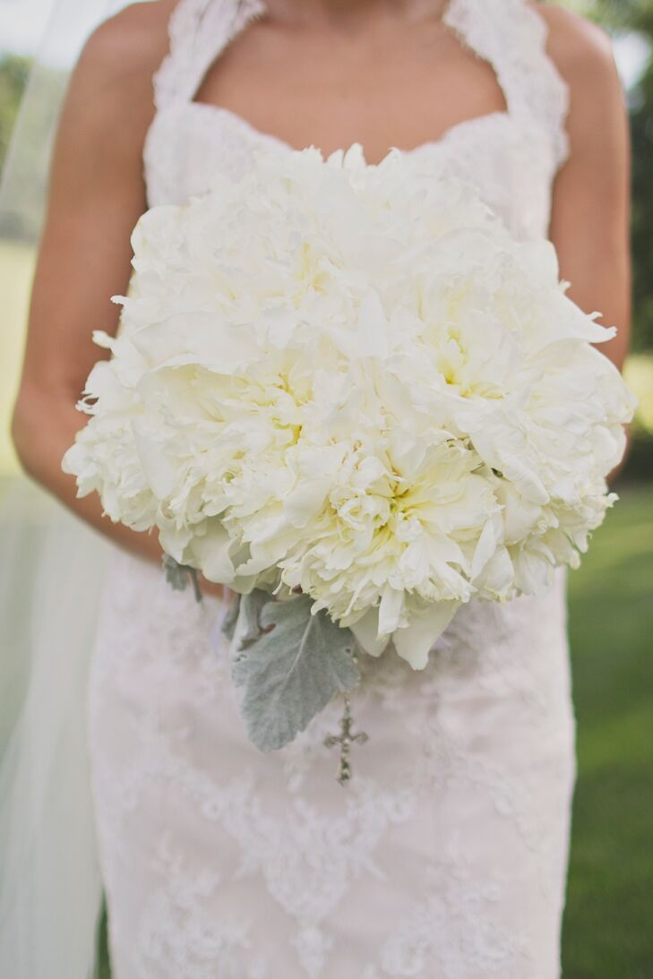 Lauren carried a lush all-white bouquet made entirely of peonies.