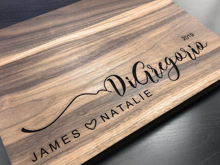 Wooden serving board engraved with couple's first names and family name