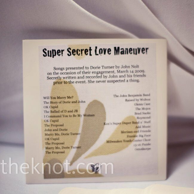 As a favor, guests also received a CD of the songs John and his friends wrote when he proposed to Dorie.