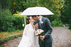 Bride and Groom Beneath a White Umbrella