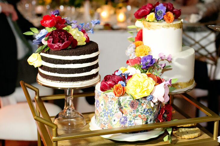 Although the couple opted for cookies from their favorite cafe, Reno, they did present three floral-topped cakes to their parents as a wedding day thank-you. One was even hand-painted with the floral design from the couple's invitation suite.