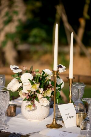 Brass Candlesticks and Ranunculus and Anemone Centerpieces