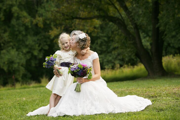 The flower girl wore a dress that used to belong to Kate. She accessorized with a deep purple sash.