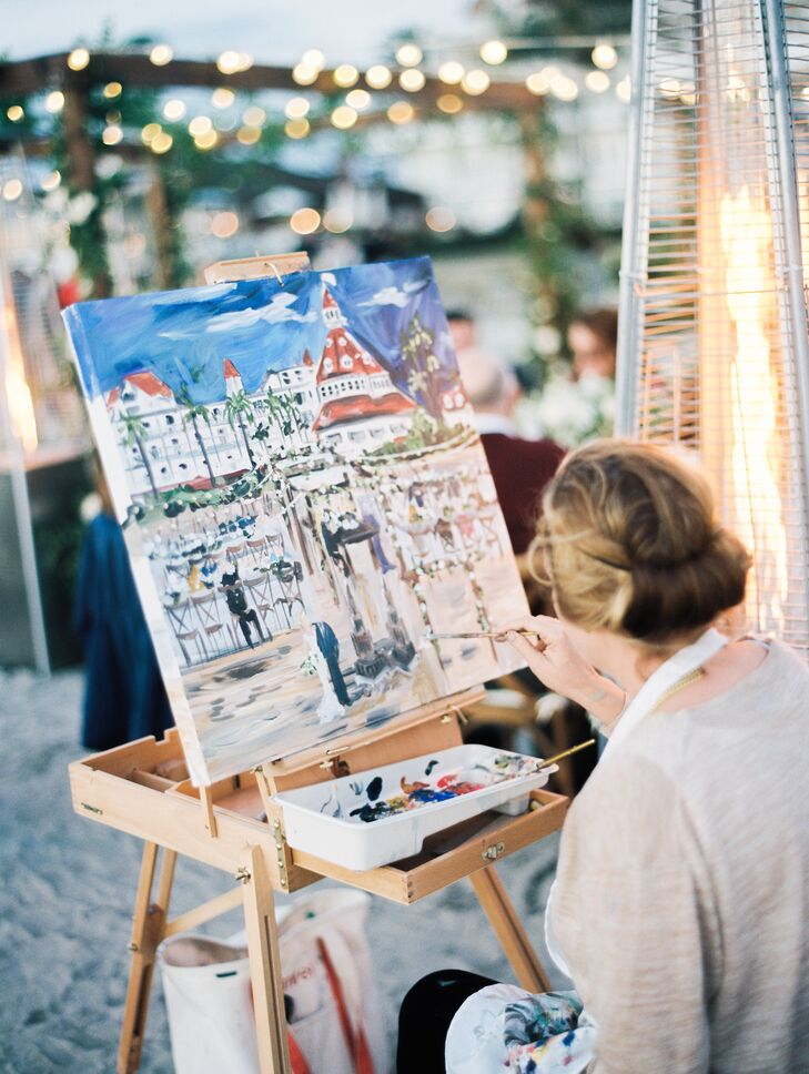"""We had a live artist paint the scene of our wedding,"" Eliza says. ""We wanted our guests to be able to watch her paint and enjoy the beauty. She made a gorgeous oil painting of our reception that is now in our living room. It reminds us every day of our perfect wedding."""