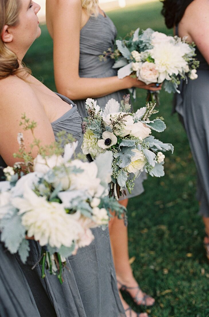 The bridesmaids' bouquets had the same sophisticated textured style as Kelly's. The bouquets were filled with ivory anemones, garden roses and dahlias accented with pale gray lamb's ear.