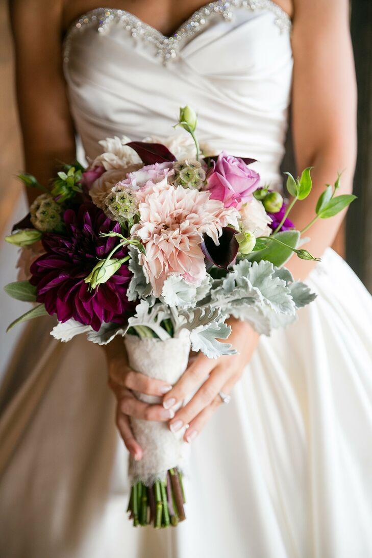 Kim's luxurious purple bouquet featured roses and large dahlia blooms.