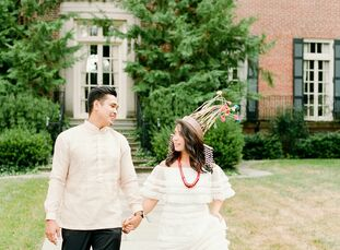 "<br>Ahead of their wedding, the couple took engagement portraits in traditional Filipino attire to honor their heritage. ""JJ's top is called a Barong"