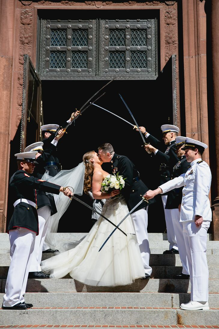 Jim swept Maura into his arms for a kiss as his groomsmen—and fellow military friends—created a saber arch.