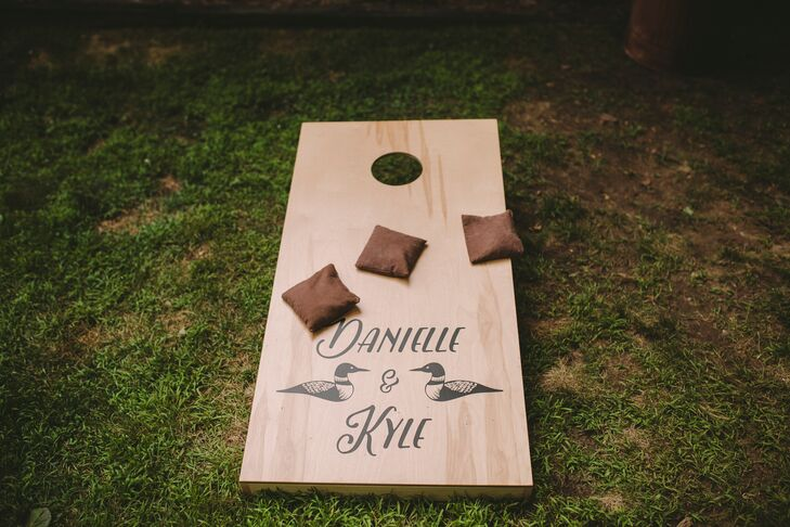 A lawn game was personalized with the couple's first names and custom wedding logo. In addition to bags, a hammock and plenty of seating made guests feel at home.