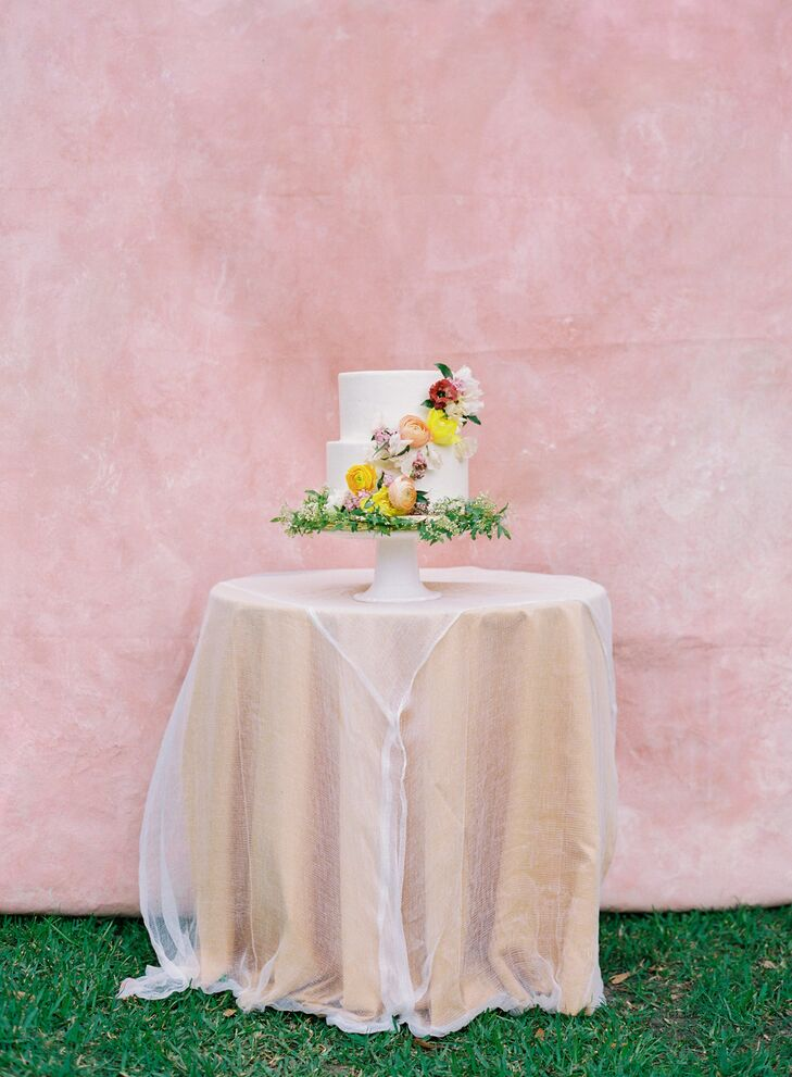 Romantic Wedding Cake with Flowers on Cake Table