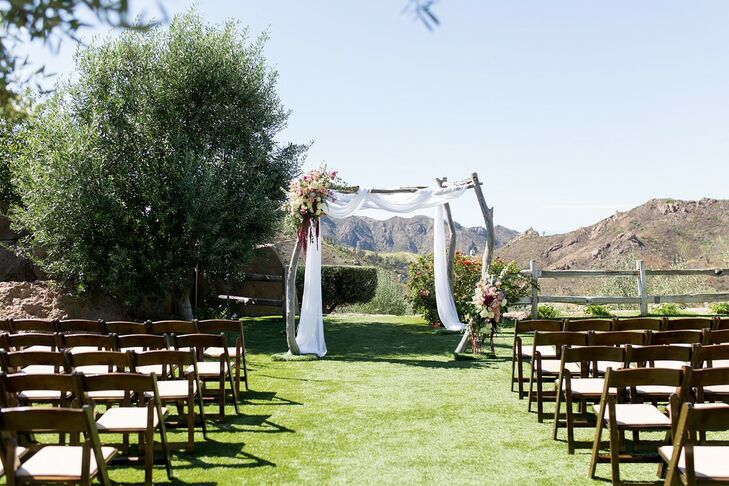 Romantic Wooden Wedding Arch with White Draping at Cielo Farms in Malibu, California