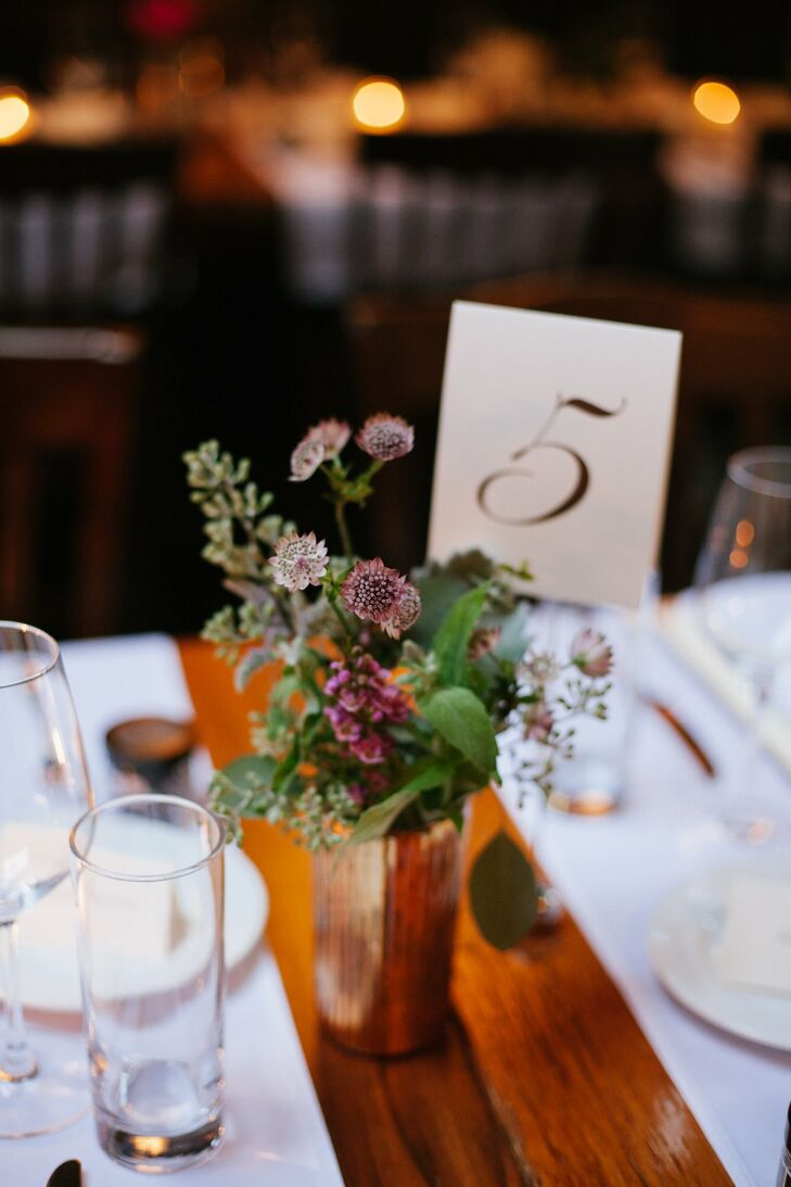 Loose, wildflower-inspired centerpieces topped tables for a fresh look.