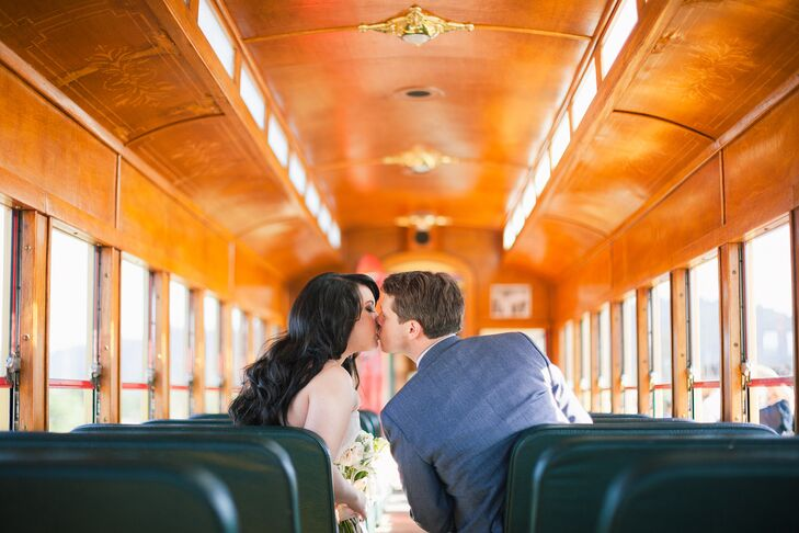 Chi and Ryan Kissing on Wood Trolley
