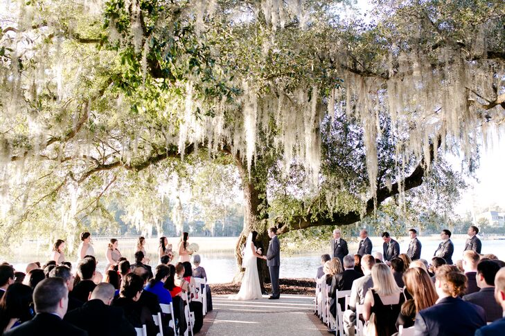 """We chose the location under several Spanish-moss-covered trees with a view of the creek since this highlighted the Southern rustic feel that we were trying to achieve,"" Gladys says. Few decorations were used so as not to  draw attention from the beauty of the trees at the ceremony site."