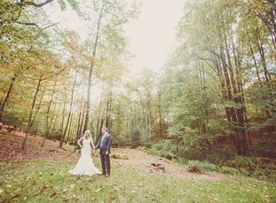 """Lauren Maurer (30 and a sales director) and Thomas Maurer (32 and a pilot) got married in the woodsy backyard of Thomas's mom's home. """"We wanted to ha"""