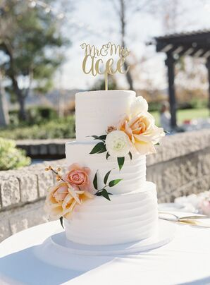 Peach and Ivory Wedding Cake With Gold Topper