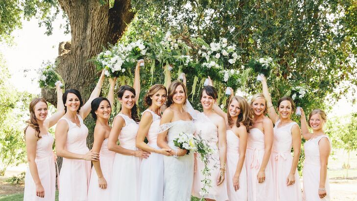 Anna stood with her bridesmaids, who wore differently styled blush dresses at the wedding.