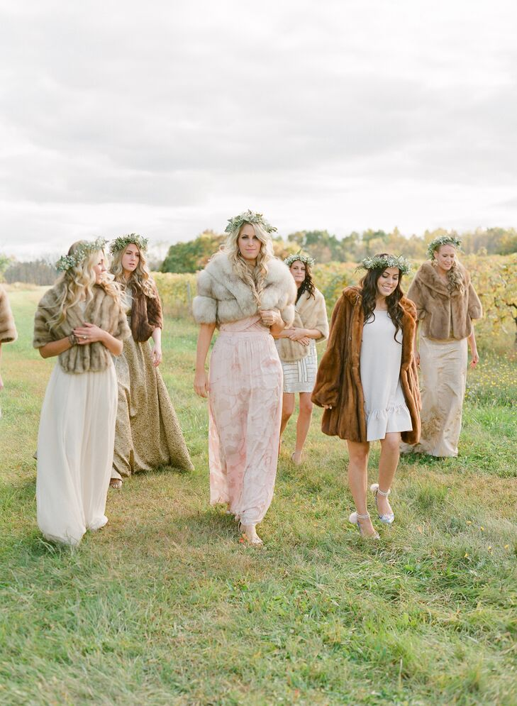 Each of Lauren's bridesmaids wore mismatched dresses in various shades of ivory and blush. Fur wraps were added for a luxe detail that was perfectly whimsical.