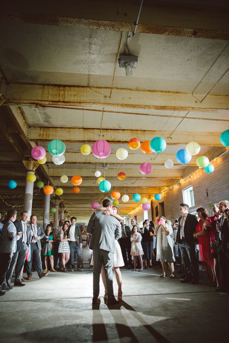 Bernice and Jason hung colorful paper lanterns over the dance floor to make the raw industrial space feel full and bright.