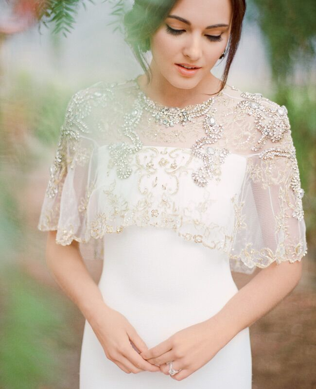 Badgley Mischka wedding dress with cape and Lulu Frost earrings | Jose Villa | blog.theknot.com