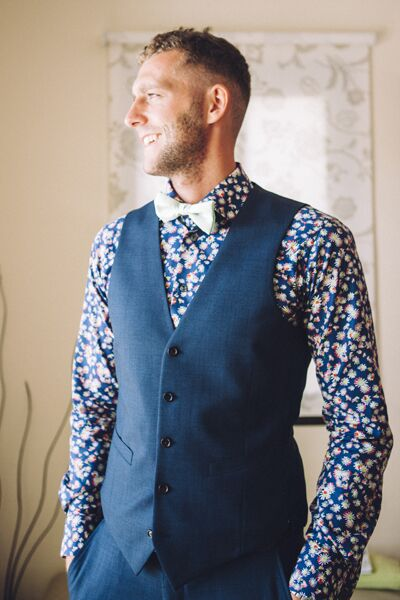 """Now talk about a creative groom. Nile designed his own suit at Andrew Gartner in Buckinghamshire, UK.  """"He wanted a unique and striking shirt... something different!"""" says Rachel."""