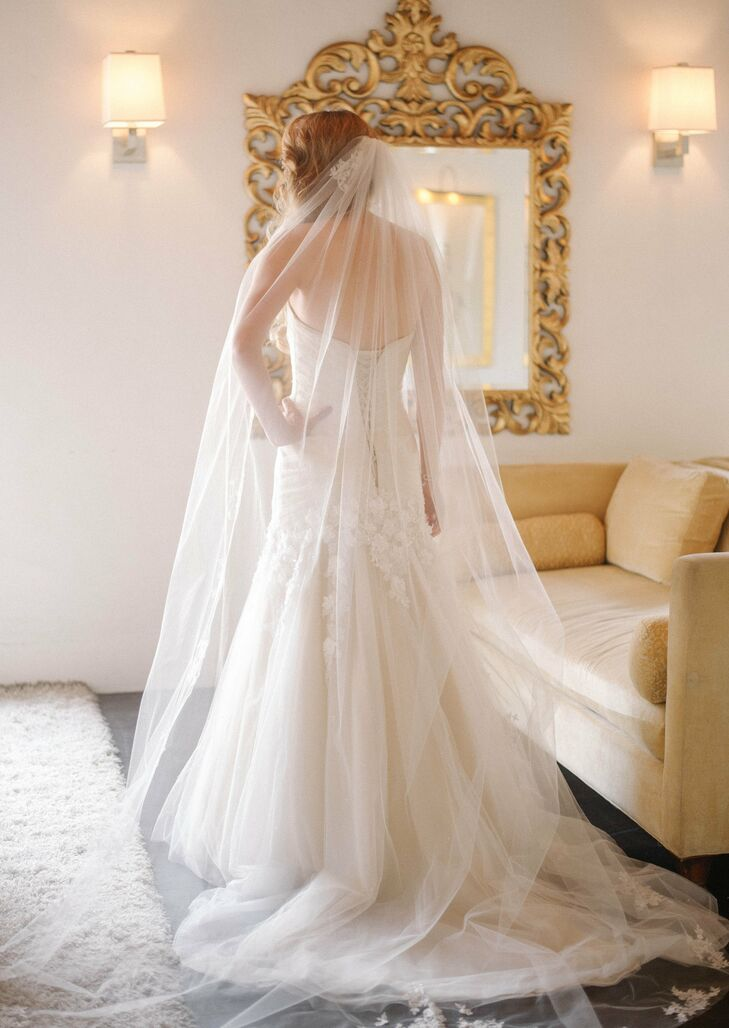Rose wore her chapel length veil low on her head for a Spanish-inspired look.