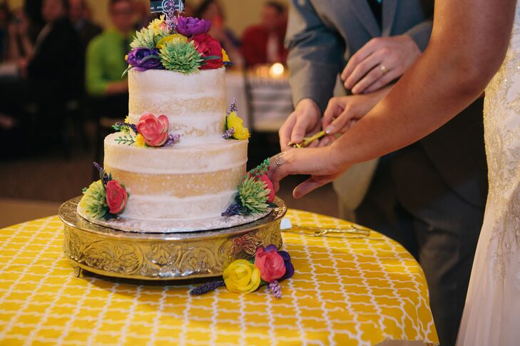 """Since I have multiple food allergies, we had a small gluten free, naked cake decorated with flowers matching the bouquets and Polaroid photos of us taken right after the ceremony on the top,"" Jodi says. ""Guests had the option of chocolate, white, strawberry, and lemon sheet cake."""