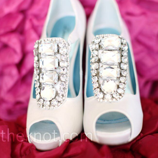 Brittney wore white satin peep-toe heels with crystal embellishments on the front to match her earrings.